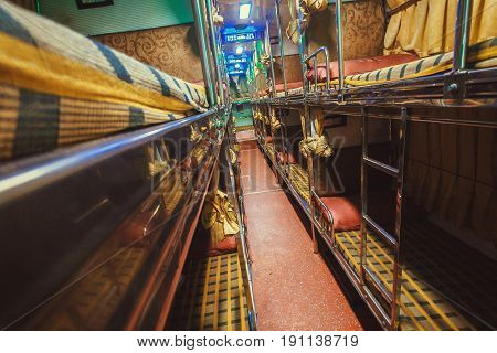 BANGALORE, INDIA - FEB 10, 2017: Corridor in empty sleeper bus for tourists and other passengers on February 10, 2017. Capital of state Karnataka has a popul. of 8.42 million