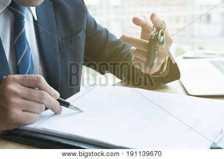 Businessman Sign Sales Contract With Car Key At Office. Ownership, Customer Buying And Salesman Sell