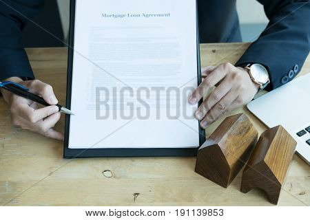 Realtor Show Mortgage Loan Agreement To His Client.  Real Estate Agent Or House Developer Present Co