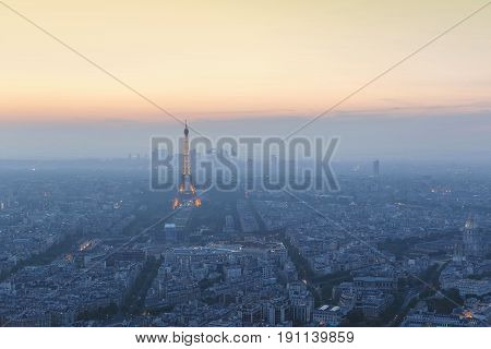 Beautiful panoramic aerial view of Paris and Eiffel tower at sunset from Montparnasse Tower Paris France