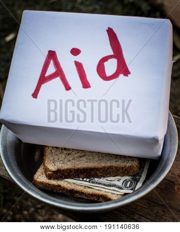 Two pieces of bread and the money is in a metal plate. Next is a box that says