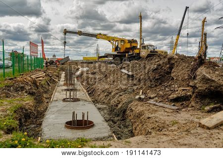 Tyumen, Russia - June 1, 2017: JSC Mostostroy-11. Construction of two-level outcome on bypass road on Fedyuninskogo and Permyakova streets intersection. Mobile crane on Construction site