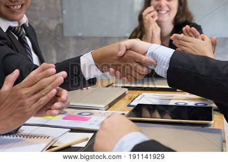 Business People Shaking Hands After Finishing Up A Meeting. Businessman Handshaking After Conference