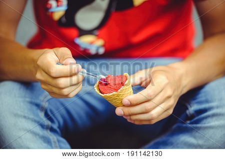 Hands Of A Man With Ice Cream