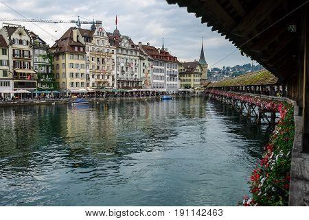 Luzerne, Switzerland - August 23, 2010: Famous Chapel Bridge in the historic city center of Lucerne Canton of Lucerne Switzerland