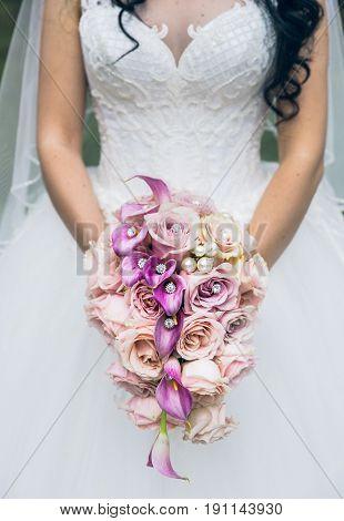 beautiful wedding bouquet bride holding in hands.