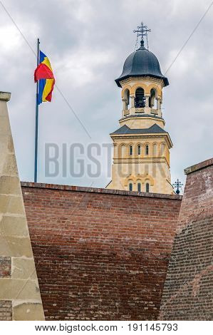 View with Bell tower from Coronation (Reunification) Cathedral in Alba Iulia city Transylvania Romania and fortress wall from Carolina citadel.