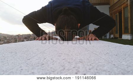 Young Adult Man Praying Outdoor, Prostration Pose.