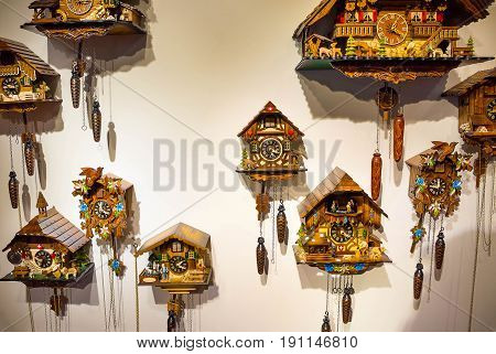 The lot of swiss wooden cuckoo clocks at wall