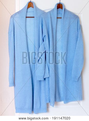 Two Cardigans Blue Related On The Spokes Of Cashmere