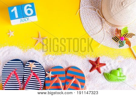 July 16th. Image of july 16 calendar with summer beach accessories and traveler outfit on background. Summer day, Vacation concept.