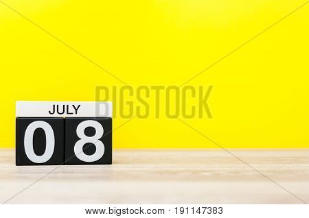 July 8th. Image of july 8, calendar on yellow background. Summer time. With empty space for text.