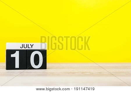 July 10th. Image of july 10, calendar on yellow background. Summer time. With empty space for text.