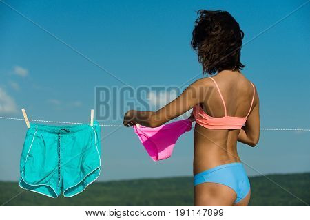 Girl Or Housewife Hang Underwear On Clothespin And Clothesline