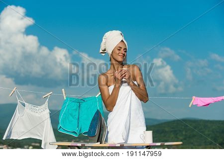 Happy Housewife In Towel Hold Coffee Cup At Clothesline