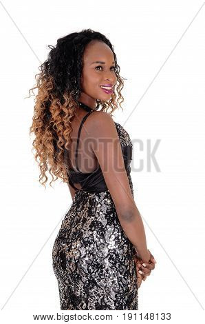 A gorgeous young African American woman with a slim figure standing from the back isolated for white background.