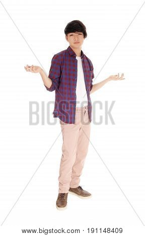 An Asian young man standing full length with his arms halve up don't know what to do isolated for white background.