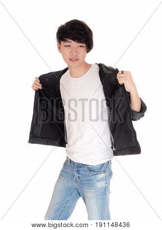 A portrait image of a young Asian man with his leather jacket open smiling isolated for white background.