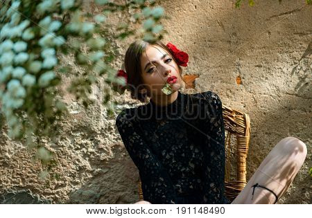 Pretty Woman Posing With White Flower In Mouth