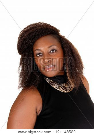 A pretty African American woman in a portrait picture with a gold necklace isolated for white background.