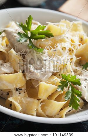 Italian chicken alfredo pappardelle pasta with cream and cheese sauce