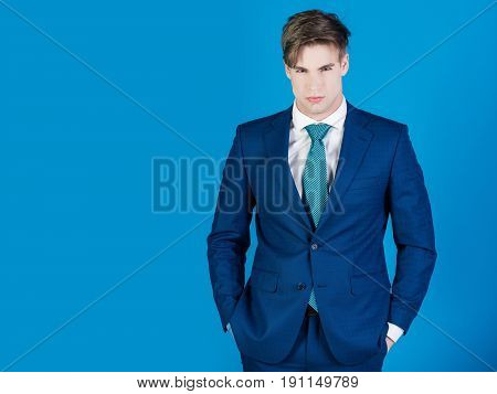 Man In White Shirt And Tie On Blue Background