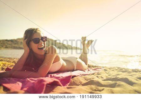 Cheerful girl at the beach