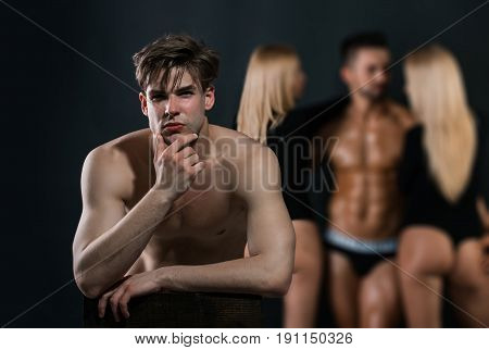 Thoughtful Man With Bare Chest Near Guy And Women