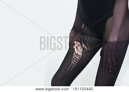 Pantyhose Or Torn Black Nylon Tights On Legs Of Woman