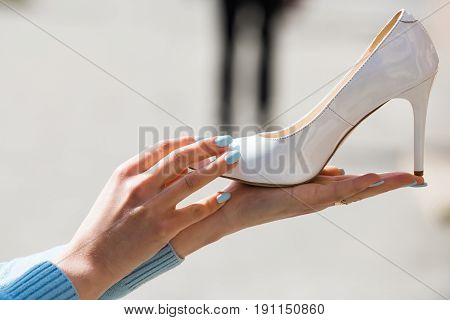 Glamour Shoe White Color Leather On Female Hand