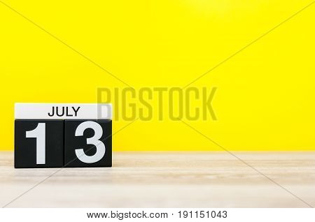 July 13th. Image of july 13, calendar on yellow background. Summer time. With empty space for text.