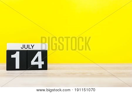 July 14th. Image of july 14, calendar on yellow background. Summer time. With empty space for text.