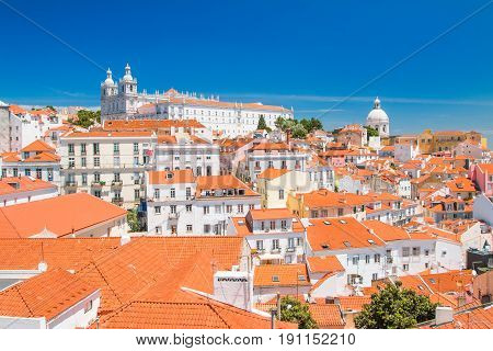 Aerial scenic view of central Lisbon Portugal with red tile roofs and monastery Igreja Sao Vicente de Fora