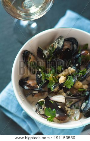 Mussels in Roquefort sauce  in the ceramic bowl top view vertical