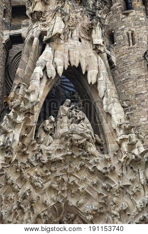 BARCELONA SPAIN - SEPTEMBER 23 2016: Detail of Nativity facade of Sagrada Familia church in Barcelona Spain. Designed by Antoni Gaudi.