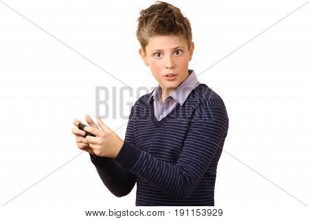 Young teenager holding a gadget looking and playing in the phone isolated on a white background