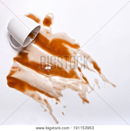 White Coffee cup spill on white background. Coffee art background