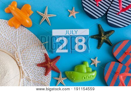 July 28th. Image of july 28 calendar with summer beach accessories and traveler outfit on background. Summer day, Vacation concept.