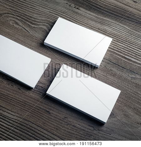 Photo of blank business cards on wooden background. Template for ID. Responsive design mock up. Top view.