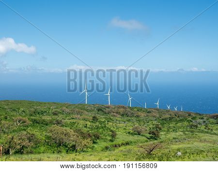 Lonely and remote Auwahi wind turbine generating station past Hana around south of Maui along the coastline