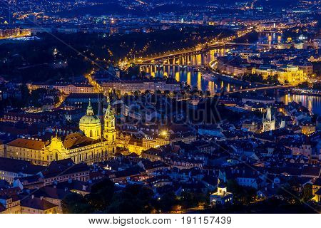 Prague at twilight blue hour, view of Bridges on Vltava with Mala Strana, Prague Castle.