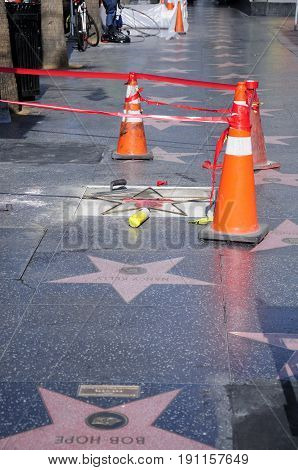 May 22 2017. Hollywood California. Repair work being done on Big Bird's star on the hollywood walk of fame on hollywood boulevard in Los Angeles california.