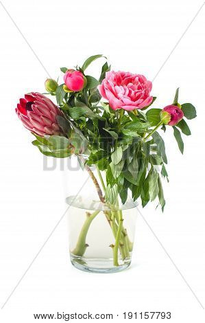 Bright Bouquet Of Freshly Cut Flowers In A Glass Vase On A Clean White Background..