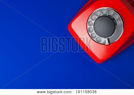medical and red telephone on blue background