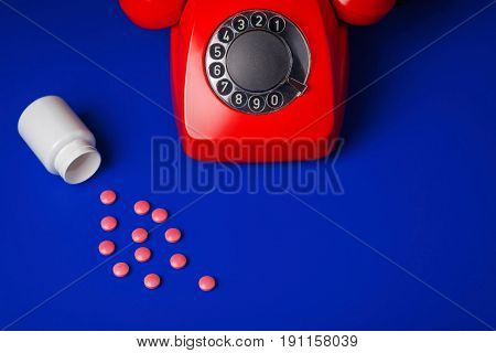 Medical Pills  And Red Telephone Blue Background