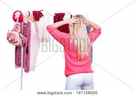 Woman In Wardrobe Choosing Clothing