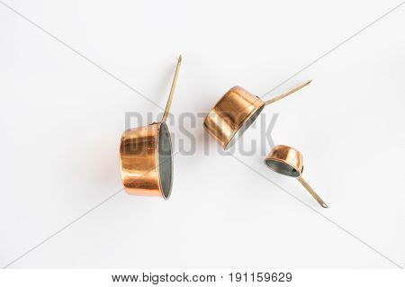 Copper Measuring cups designed on a white background