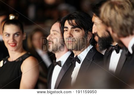 Faith Akin, Numan Acar attend the 'In The Fade (Aus Dem Nichts)' premiere during the 70th annual Cannes Film Festival at Palais des Festivals on May 26, 2017 in Cannes, France.