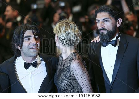 Faith Akin, Diane Kruger, Numan Acar attend the 'In The Fade (Aus Dem Nichts)' premiere during the 70th Cannes Film Festival at Palais on May 26, 2017 in Cannes, France.