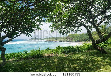 Waves break on Hamoa beach near Hana on Hawaiian island of Maui